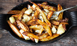 3. Try Delicious Canadian Poutine